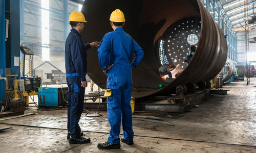 Engineers discussing on Fabrication Bucket