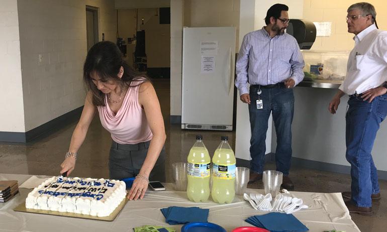 Miriam cuts the ISO 9001 celebration cake!