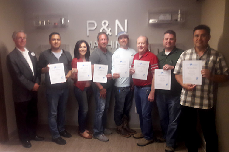 Root Cause Analysis class participants display their diplomas after a full day of training with Mireaux's Instructor R. Berrns