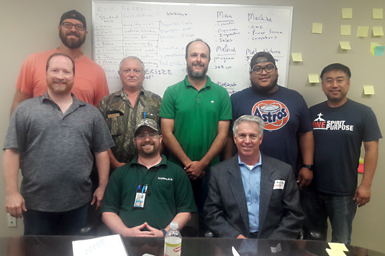 Mireaux's instructor, R. Berrns, poses with the P&N Machine Shop team after a full day of Root Cause Analysis Training.